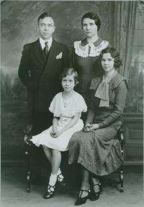 My mother, seated at left, with her parents and older sister.